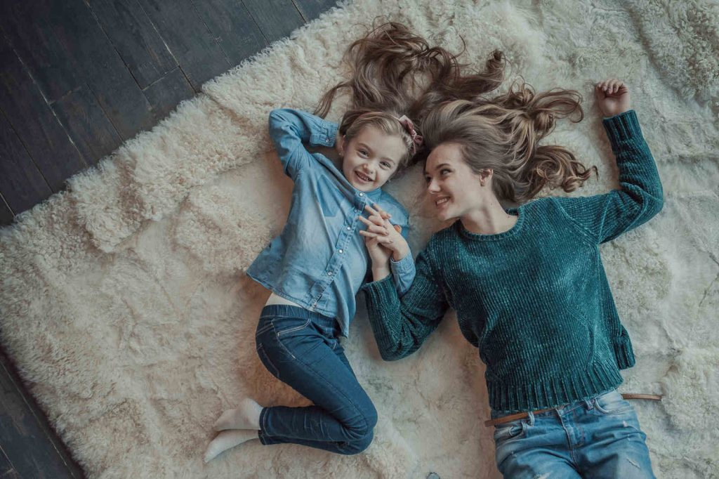 mom and child on carpet
